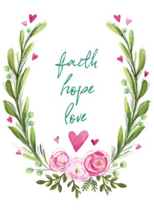 Floral arrangement with hearts all around and the words Faith Hope and Love