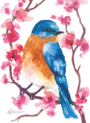 Blue bird in a tree with pink flowers close up